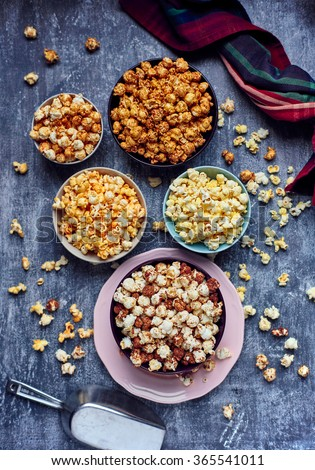 Five bowls of various flavored popcorn. Sweet popcorn. Salty Popcorn. Pop corn. Popcorn. Popcorn. - stock photo