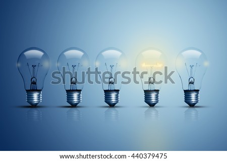 Five bulbs on a blue background and one of them is glowing.