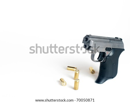 Five bullets and handgun with place for text - stock photo