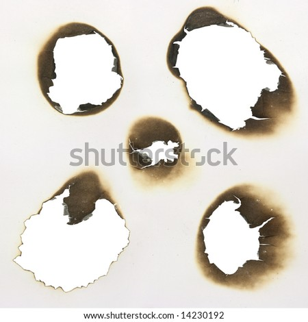 five  burned holes in a paper