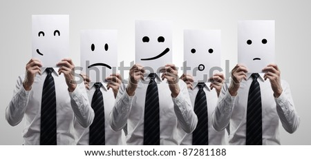 Five business men holding a card with emotional face. On a gray background - stock photo