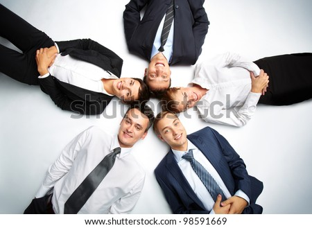 Five business people looking at camera and smiling