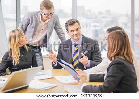 Five business people working together in the office
