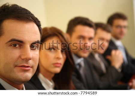 five businesspeople at the meeting portrait - stock photo