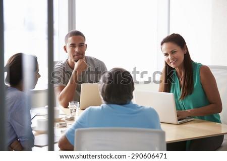Five Businesspeople Having Meeting In Boardroom - stock photo