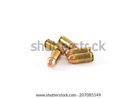 Five .45 caliber cartridges - stock photo