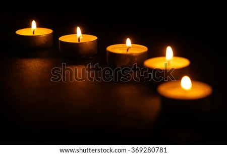 Five candles in line at dark