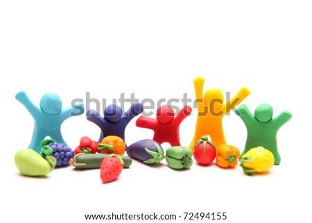 five cheerful plasticine guys happy with different types of healthy fruits and vegetables - stock photo
