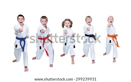 Five children are doing blow in the air and shout - stock photo