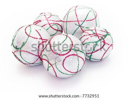 five Christmas balls grouped on white background