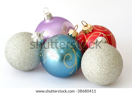 Five christmas balls isolated over white background