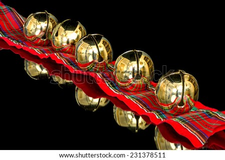 Five Christmas bells on a colorful ribbon - stock photo