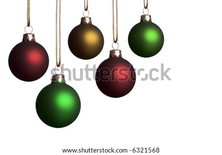 Five christmas ornaments in various sizes hanging isolated on a white background - with copyspace. - stock photo