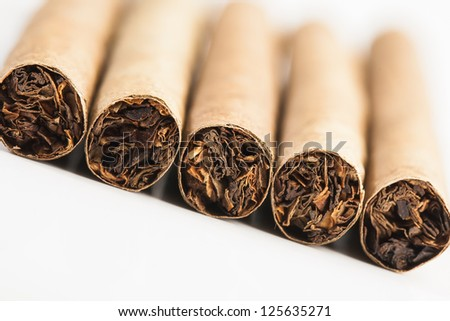 Five cigars being photographed from a angle. - stock photo