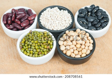 Five colored beans in bowl. - stock photo