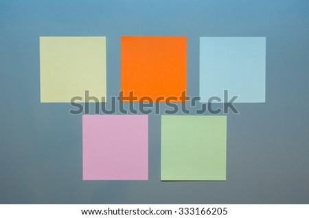 Five colored empty reminders on a grey panel - stock photo