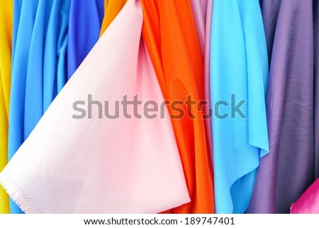 Five colored fabric tie background. - stock photo