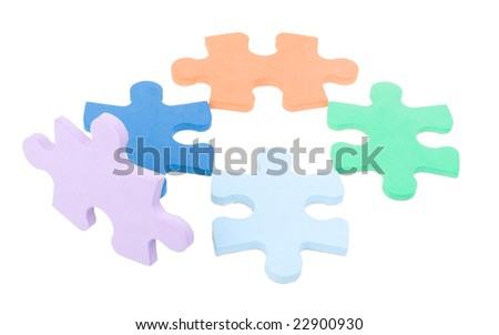 five colored puzzle blocks isolated