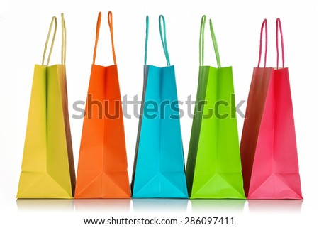 five colorful shopping bags closeup isolated on white - stock photo