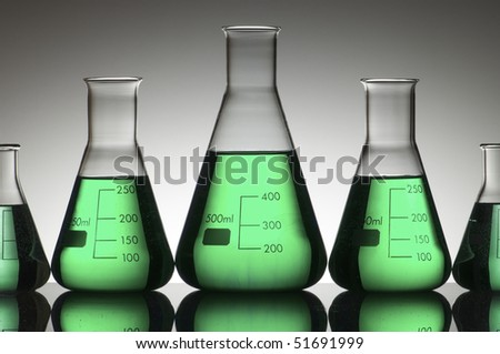 five conical glasses laboratory on a white background - stock photo