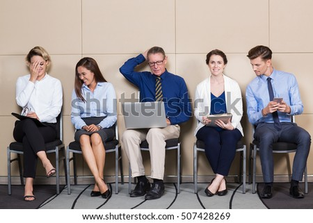 Five Content Applicants Sitting in Waiting Room