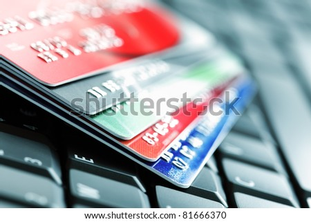 Five credit cards on a computer keyboard concept for e-commerce - stock photo