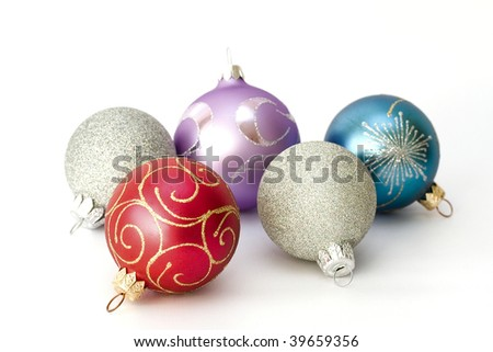 Five different color christmas balls isolated on white background