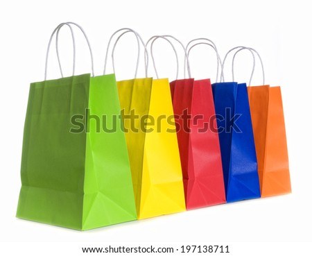 Five different colored shopping bags in a row.