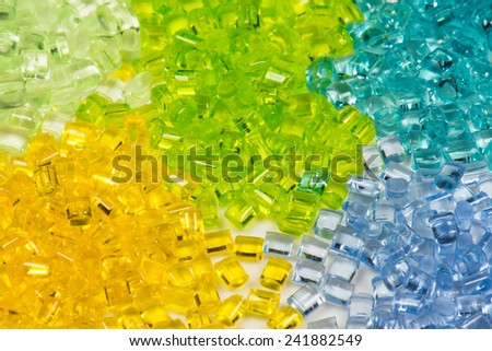 five different translucent polymer pellets for injection moulding - stock photo