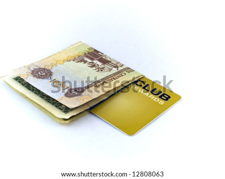 Five Dirham Note and Gold Membership Club Card on White Background - stock photo