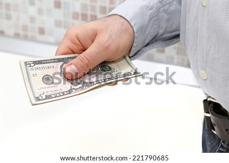 Five dollar bills in man hand