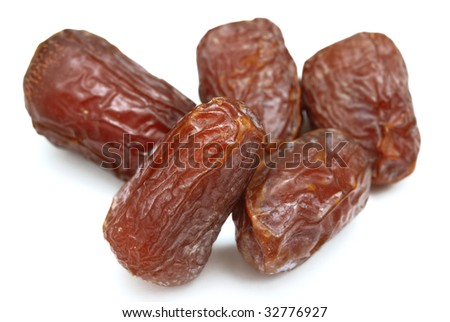 Five dry dates isolated on white background.