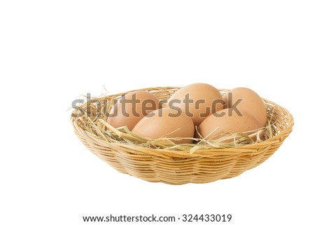 five eggs with dry grass in the basket.