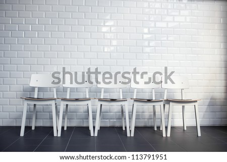 Five empty chairs in waiting room - stock photo