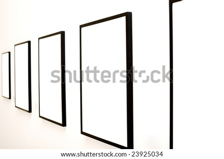 Five empty frames on white wall exhibition in Museum - stock photo