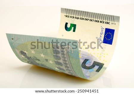 Five euros banknote closeup of on a light background.