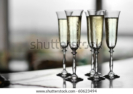 Five fancy glasses of champagne - stock photo