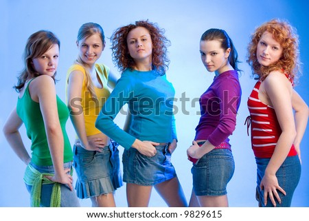five fashionable girls are looking into the camera