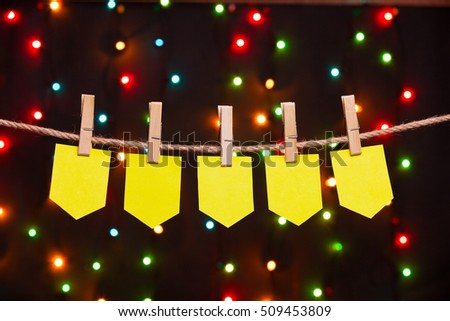 five festive flags on the background of colored lights
