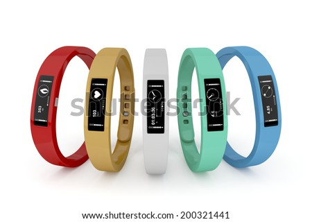 Five fitness trackers with different interfaces and colors  - stock photo