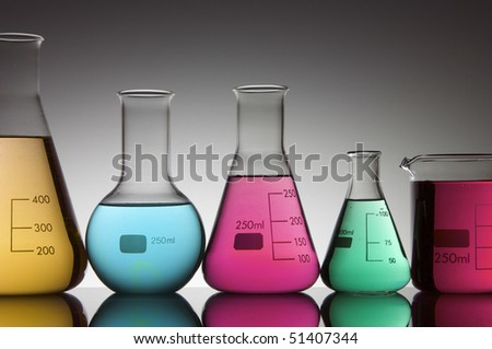 five flasks with bright colored liquid