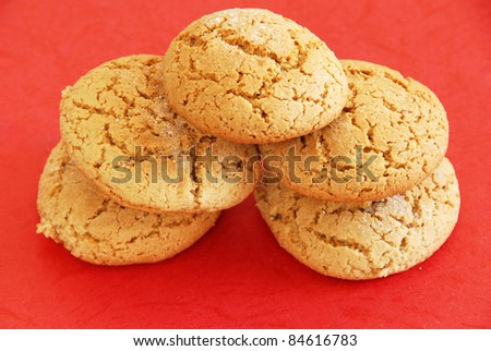 five fresh appetizing oatmeal cookies over red background
