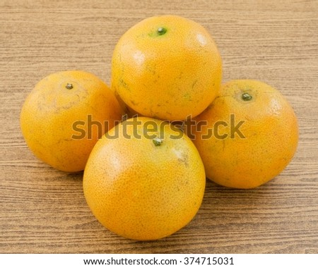 Five Fresh Ripe and Sweet Oranges on A Wooden Table, Orange Is The Fruit of The Citrus Species. - stock photo