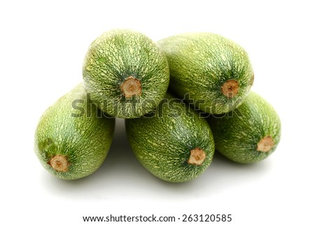 five freshly green zucchini on white background  - stock photo