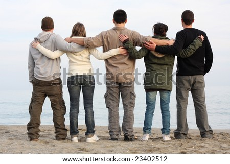 Five friends together by the sea - stock photo