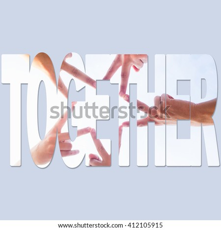 Five friends uniting their hands to make a star on the beach at summer - stock photo