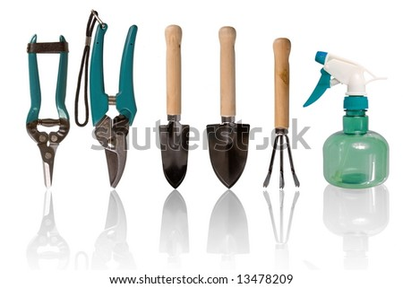 Five gardening tools kit and one spraying bottle - stock photo
