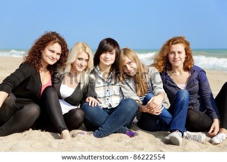 Five girls at outdoor near beach - stock photo