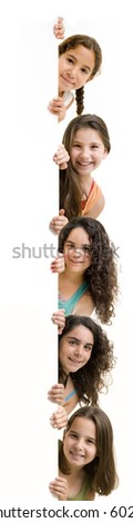 five girls peeking behind a white wall or sign isolated on white.
