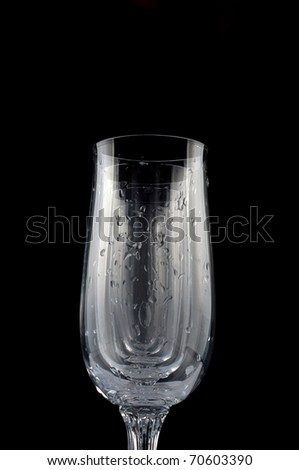 Five glasses each other, with drops of water isolated on black background. All image in focus.